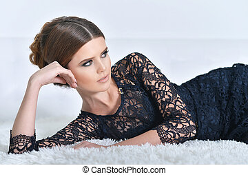 young gorgeous woman in black dress