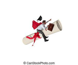 Young graduate boy rides a graduation parchment