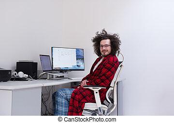 graphic designer in bathrobe working at home