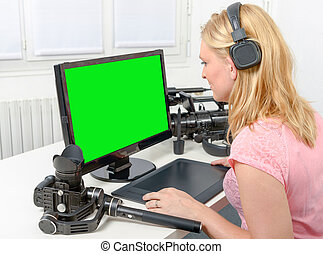 Young graphic designer working on computer using tablet