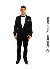 Young groom in a tuxedo - A portrait of a young groom in a...