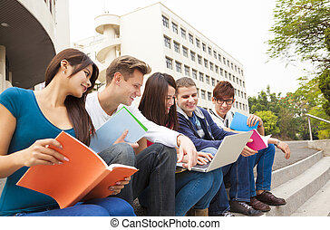 young group of university students studying