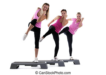 young group women training on stepper isolated - young group...