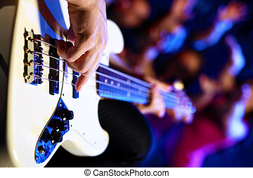 Young guitar player performing in night club - Young guitar...