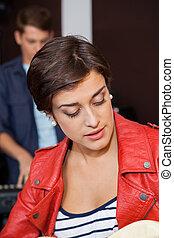Young Guitarist Singing In Recording Studio