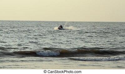 Young guy cruising on a jetski