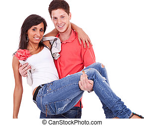Young guy holding his girlfriend in his arms