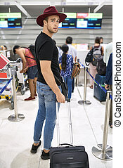 Young guy in airport