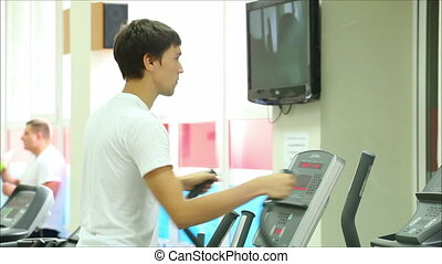 young guy in the gym for sports
