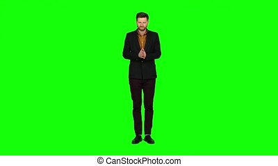 Young guy is happy with his victories, he is happy. Green screen