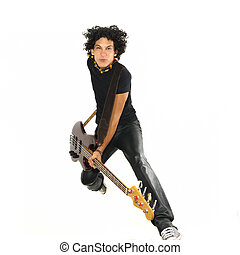 Young guy jumping with electric bass guitar