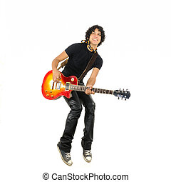 Young guy jumping with electric guitar