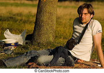 young guy on the grass