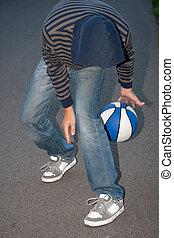 Young guy playing basketball