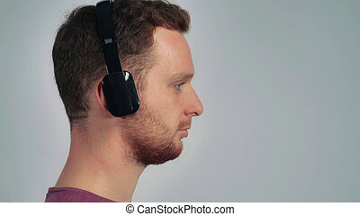 Young Man Using Headphones Young Happy Man With Dark Hair