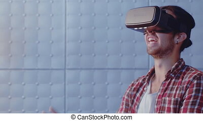 Young guy visualized virtual woman wearing virtual reality headset trying to adjust reality. Man touch virtual wall using modern vr glasses indoors. Modern technologies. Prores 422.