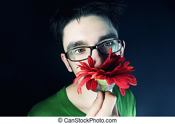 guy with a red flower on a black background