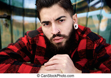 Young guy with beard and piercings - Close up portrait of a...