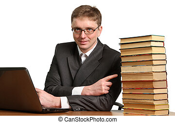 young guy working at a laptop
