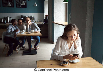 Young guys interested with girl sitting near in cafe