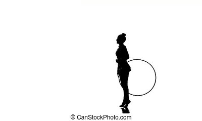 Young gymnast doing tricks with the hoop