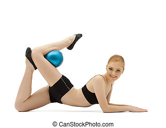young gymnast posing with blue ball
