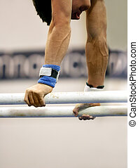 Young gymnast competing on parallel bars