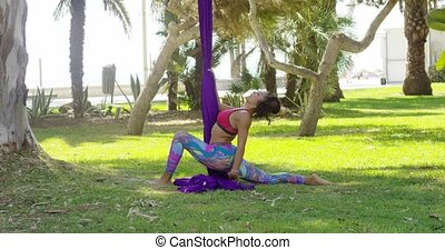 Young gymnast working out with ribbons