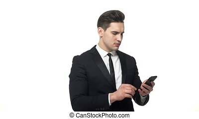 Young hadnsome Businessman Typing on mobile with serious...