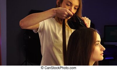 young hair stylist make hairstyle with beautiful woman at...