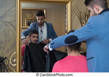 Young Hairdresser Making Preparation Before Giving A Haircut