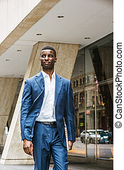 Young Handsome African American Businessman traveling, working in New York