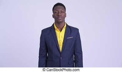 Young handsome African businessman in suit