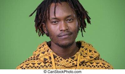 Young handsome African man nodding head yes - Studio shot of...