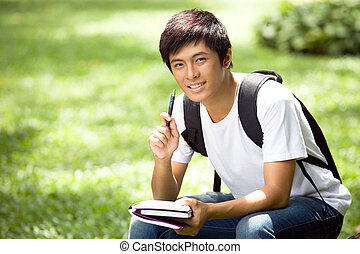 Young handsome asian student in the campus