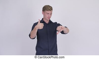 Young handsome blonde businessman making decisions - Studio ...