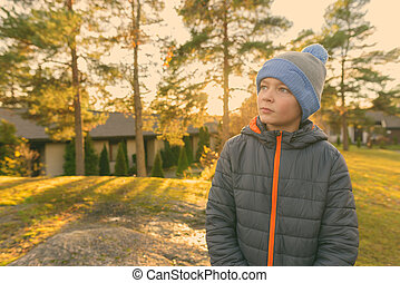 Young handsome boy getting away from it all with nature - ...