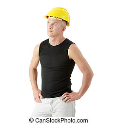 Young handsome builder in yellow helmet.