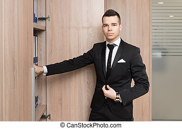 Young Handsome Businessman In Black Suit