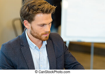 young handsome businessman in modern office