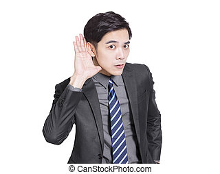 Young handsome businessman listening carefully to something.Isolated on white background.
