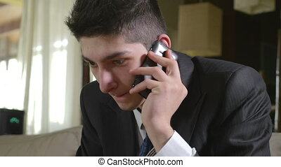 Young handsome businessman talking at the smart phone