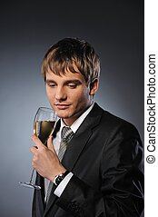 Young handsome businessman with a glass of champagne