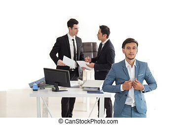 Young handsome businessman with blue suit