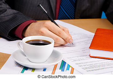 Young handsome businessman working with documents