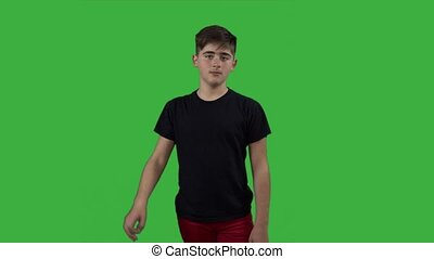 young handsome child boy shows one thumb on agreement - green screen