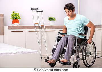 Young handsome disabled man recovering at home