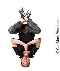 Young handsome fresh man breakdancing on white background -...