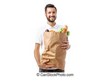 Young handsome hipster man holding a bag of food isolated on a white background.