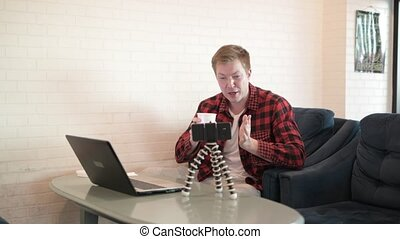 Young Handsome Hipster Man Vlogging While Drinking Coffee And Using Laptop